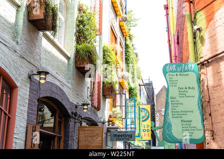 London, UK - May 15, 2019: Colorful buildings in Neals Yards in Seven Dials, it s a small alley in Covent Garden area between Shorts Gardens and Monmo - Stock Image