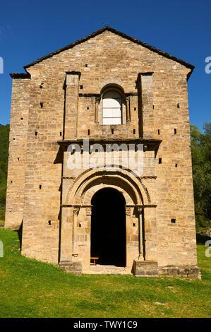 Frontage of the XI century romanesque church and monastery of Santa María de Iguácel in Garcipollera valley (Larrosa, Huesca, Aragón, Pyrenees, Spain) - Stock Image
