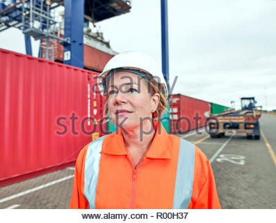 Dock manager portrait standing by containers at train side freight - Stock Image