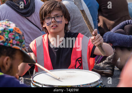 London, UK. 17th April 2019. A drummer keeps up the beat. Two days after Extinction Rebellion closed Waterloo Bridge turning it into a 'Garden Bridge' it remains closed to traffic despite a couple of hundred arrests. Activities continue on the bridge with new protesters arriving. Credit: Peter Marshall/Alamy Live News - Stock Image