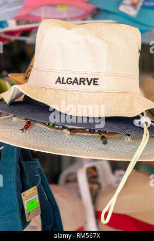 A Canvas Souvenir Sun Hat For Sale With Algarve Embroidered On The Front Display In A Tourist Shop Albufeira Portugal - Stock Image
