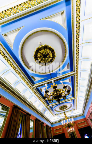 Ceiling and chandeliers in the ballroom of the Harbour Commissioners' Office building, Belfast. - Stock Image