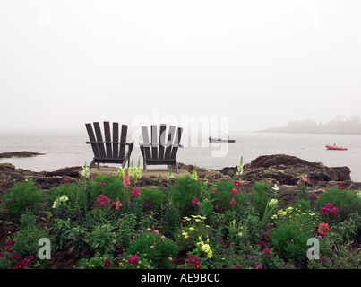 Chairs overlooking Maine ocean view - Stock Image