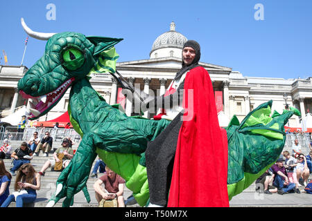 Trafalgar Square. London, UK. 20th Apr, 2019. A man dressed as St George on a dragon attends the annual 'Feast of St George' event in Trafalgar Square, to celebrate the Patron Saint of England. St George's Day is on 23 April. Credit: Dinendra Haria/Alamy Live News - Stock Image