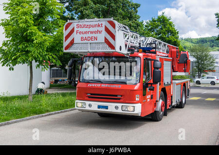 Iveco Magirus 160E30 turntable ladder truck of a Swiss fire brigade. Ladder and platform retracted. - Stock Image