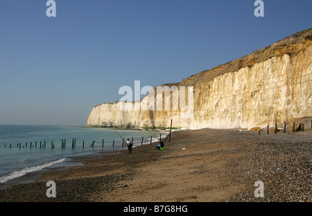 Fisherman at Castle Hill Beach and Chalk Cliffs, Newhaven, East Sussex, UK - Stock Image