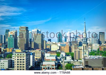 Montreal, Quebec, Canada-May 29, 2019: Urban skyline of the famous Canadian city which is a major tourist attraction in the country. Daytime aerial vi - Stock Image