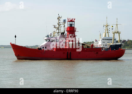Trinity House lightship under tow, Harwich Haven, Essex, UK. - Stock Image