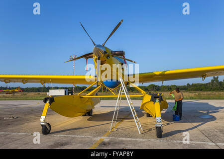 Aircraft mechanic and Air Tractor AT 802 A Fire Boss with floats Zemunik AFB Croatia - Stock Image
