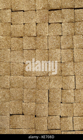 Background image of brown sugar cubes - Stock Image