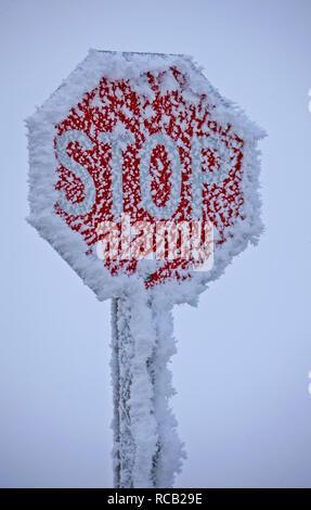 Winter Frost Saskatchewan Canada ice storm stop sign - Stock Image