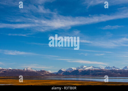Greenland. East Greenland. Constable Point. Snow-covered hills in the distance. - Stock Image