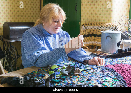 Demonstration of Rag Rugging at Beamish Living Open Air Museum - Stock Image