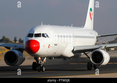 Danish Air Transport Airbus A320 jet plane taxiing for departure. Modern aviation. Closeup front view. - Stock Image