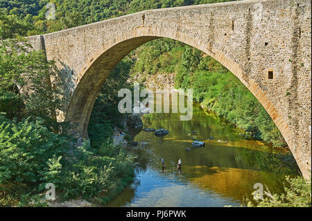 Pont Grand across the River Doux in the Ardeche region of France, is a medieval stone bridge near Tournon sur Rhone. - Stock Image