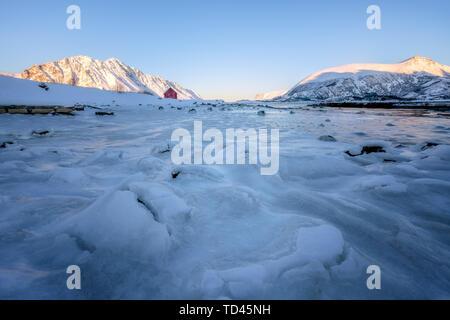 Rorbuer (fisherman's hut) on a frozen lake, Lofoten, Nordland, Arctic, Norway, Europe - Stock Image