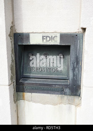 Old bank or savings institution or credit union depository for money deposits also known as a night deposit box, in Montgomery Alabama, USA. - Stock Image