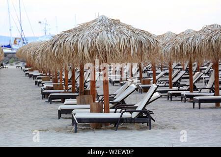 Black Sea Sand Beach With Wooden Sun Loungers And Straw Umbrellas At Sveti Vlas, Bulgaria, Europe - Stock Image