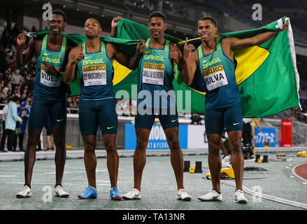 YOKOHAMA, JAPAN - MAY 12: Jorge Vides, Rodrigo Do Nascimento, Paulo André Camilo De Oliveira and Derick Silva of Brazil after they won the mens 4x100m relay final during Day 2 of the 2019 IAAF World Relay Championships at the Nissan Stadium on Sunday May 12, 2019 in Yokohama, Japan. (Photo by Roger Sedres for the IAAF) - Stock Image