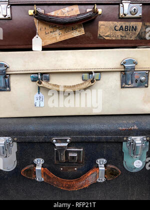 Old vintage suitcases for sale on a market in London, England. - Stock Image