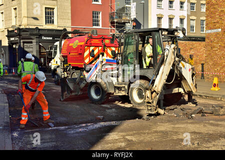 Road resurfacing works with machines used in the process including breaker and sweeper, England, UK - Stock Image
