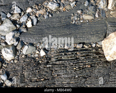Rock and stone in Recherchefjord on the south west coast of Spitsbergen, Svalbard archipelago Norway. - Stock Image