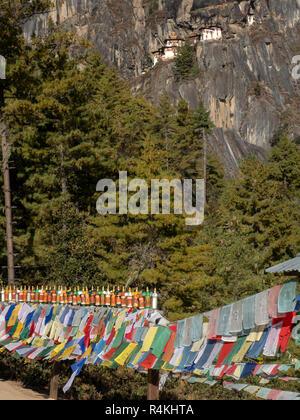 Prayer Flags on the path to Taktsang Monastery, Bhutan - Stock Image