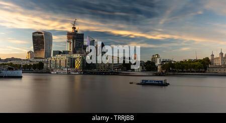 London, England, UK - September 27, 2018: Sunset lights up skyscrapers of the City of London skyline. - Stock Image