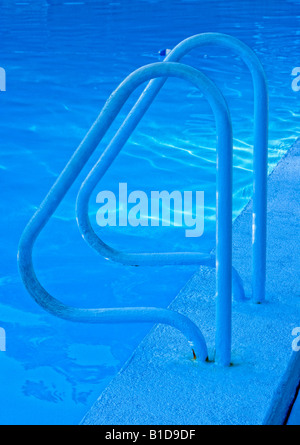 Graphic blue image of swimming pool ladder - Stock Image