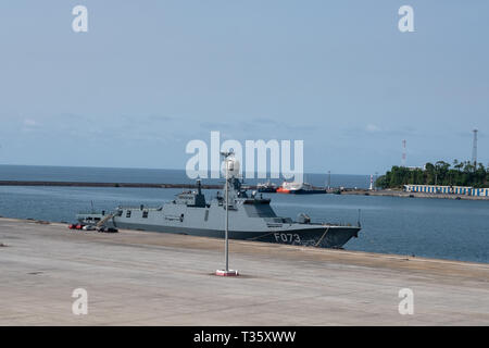 The flagship of the Equatorial Guinea navy alongside a dock in the harbour in Malabo, the capital - Stock Image
