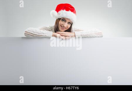 Santa Women, with white board - Stock Image