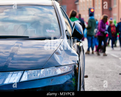 Ashbourne, UK. 11th February, 2018. Parked car damaged by the pressure of the scrum at Ashbourne Royal Shrovetide - Stock Image