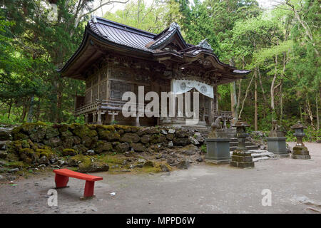 Facade of empty Towada Shinto shrine surrounded by trees. Aomori prefecture, North Honshu, Japan. - Stock Image