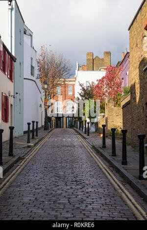Back Lane, a pretty narrow, cobbled street of houses in Hampstead, London, England, UK - Stock Image
