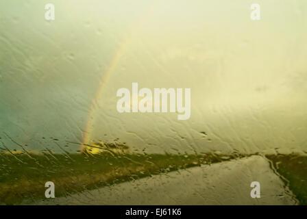 Rainbow on the road - Stock Image
