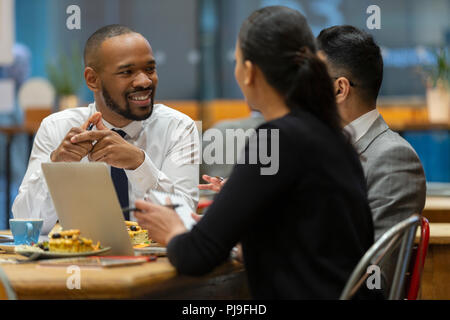 Business people meeting, working in cafe - Stock Image