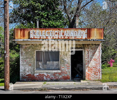 Abandoned and deserted closed Eclectic Laundry business old brick building in rural Eclectic Alabama, USA. - Stock Image