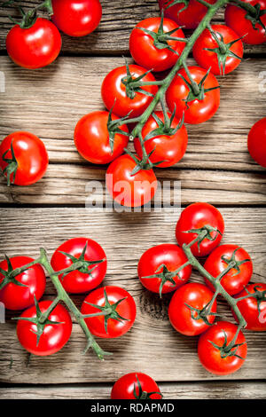 Fresh ripe tomatoes. On a wooden background. - Stock Image