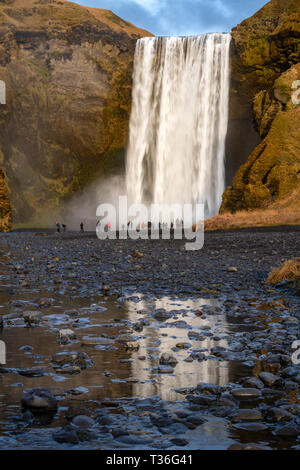Skógafoss is one of Iceland's biggest and most beautiful waterfalls with an astounding width of 25 meters (82 feet) and a drop of 60 meters (197 feet) - Stock Image