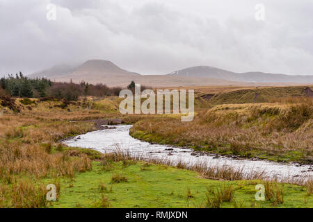 Clouds over the Carmarthen Fans with Fan Brycheiniog mountain  in the Brecon Beacons National Park landscape, Carmarthenshire, Wales, UK - Stock Image