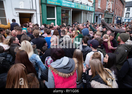 People celebrating at the end of the Atherstone ball game 2019 - Stock Image
