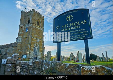 The parish church of St Nicholas, Abbotsbury, Dorset on a spring morning under a blue sky. - Stock Image