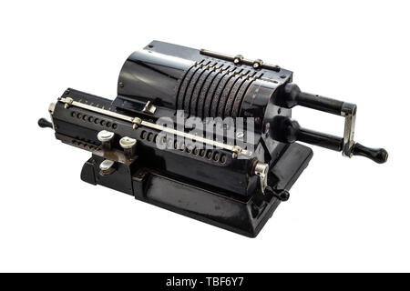 Ancient pinwheel mechanical calculator.The calculating machine, is a mechanical device used to perform automatically the basic operations of arithmeti - Stock Image