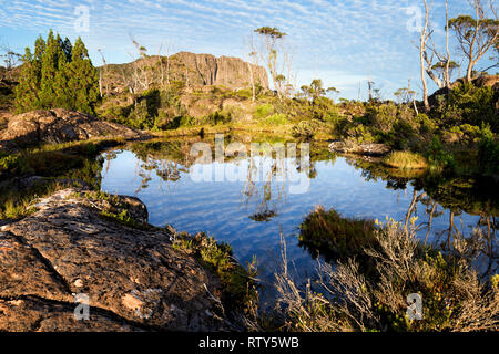 Sunrise over Walled Mountan in Cradle Mountain–Lake St Clair National Park, Tasmania in Cradle Mountain–Lake St Clair National Park, Tasmania - Stock Image
