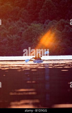 active person kayaking at dusk - Stock Image