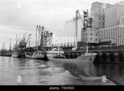 Early 1970s photo of ships moored against Spillers flour mill wharf in Newcastle upon Tyne, England, UK - Stock Image