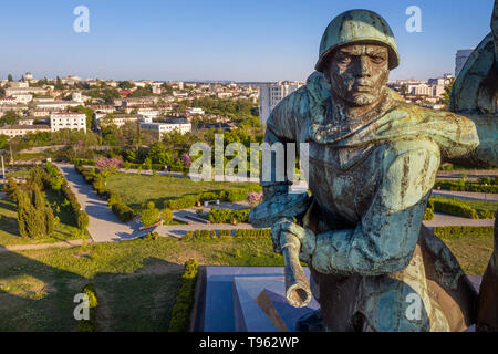Close-up fragment of the monument to the heroic defenders of Sevastopol 'Sailor and Soldier' on Cape Crystal and panoramic views of the city of Sevast - Stock Image