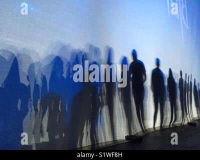 Shadows on back cyclorama on a stage. - Stock Image