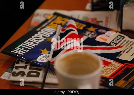 Hastings, East Sussex, UK. 10 Jan, 2019. Wetherspoon founder and chairman Tim Martin visited The John Logie Baird pub in Hastings, East Sussex. He will talk to members of the public about what he considers to be the huge economic advantages of leaving the EU. Wetherspoons brochure with british flag on a coffee table in the pub. © Paul Lawrenson 2018, Photo Credit: Paul Lawrenson / Alamy Live News - Stock Image