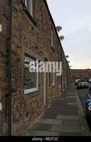 Terraced housing in Amble Dovecote Street in Amble.  Amble is a small town on the north east coast of Northumberland in North East England. - Stock Image